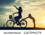 silhouette of mother with her...   Shutterstock . vector #1267094179