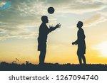 silhouette of children play...   Shutterstock . vector #1267094740