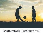 silhouette of children play...   Shutterstock . vector #1267094743