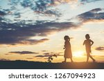 silhouette of children playing    Shutterstock . vector #1267094923