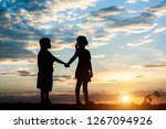 silhouette of children playing    Shutterstock . vector #1267094926