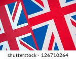 Two Union Jack Flags of UK as a Background - stock photo