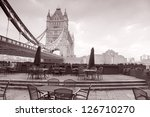 Tower Bridge in London and Cafe Terrace, England, UK in Black and White Sepia Tone - stock photo