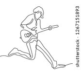 man jumping with guitar... | Shutterstock .eps vector #1267151893