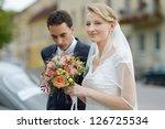 beautiful bride holding wedding ... | Shutterstock . vector #126725534