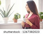 young attractive girl sitting...   Shutterstock . vector #1267382023