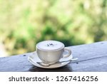 white cup of cappuccino coffee... | Shutterstock . vector #1267416256