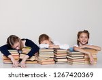 three girls schoolgirls at a... | Shutterstock . vector #1267420369