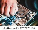 asian laptop repair technician... | Shutterstock . vector #1267423186