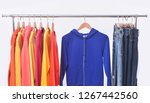 fashionable clothing on hangers ...   Shutterstock . vector #1267442560