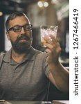 handsome man holding crystal... | Shutterstock . vector #1267466419