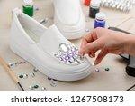 girl adding rhinestones to... | Shutterstock . vector #1267508173