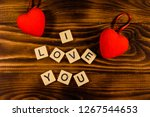 Two Red Hearts On Rustic Woode...