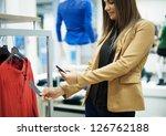 smiling woman scanning qr code... | Shutterstock . vector #126762188