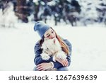 beauty woman hugging her dog...   Shutterstock . vector #1267639639