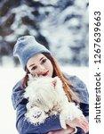 winter portrait of cute woman...   Shutterstock . vector #1267639663