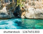 rocky cliff by turquoise sea in ... | Shutterstock . vector #1267651303