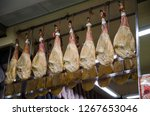 jamon iberico hanging in the... | Shutterstock . vector #1267653046