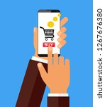 hand holing smart phone with...   Shutterstock . vector #1267676380