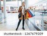 girl looks at something in her... | Shutterstock . vector #1267679209