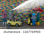 happy girl with children washes ... | Shutterstock . vector #1267765903