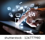 hand touching digital tablet ... | Shutterstock . vector #126777980