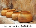 Clay Pots On A Shelf In The...