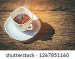 close up of a cup of coffee... | Shutterstock . vector #1267851160