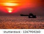 Silhouette Of The Cargo Ship...
