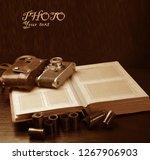 old photo album  old camera ... | Shutterstock . vector #1267906903
