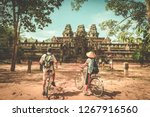 tourist couple cycling around... | Shutterstock . vector #1267916560