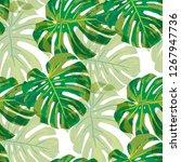 tropical leaves. seamless... | Shutterstock .eps vector #1267947736