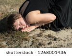 woman lying on the ground ... | Shutterstock . vector #1268001436