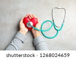woman holding red heart and... | Shutterstock . vector #1268024659