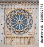 Rose window from the facade of the Duomo of Spoleto. Umbria, central Italy. July-25-2018