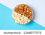 different kinds of popcorn in... | Shutterstock . vector #1268077573