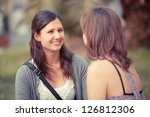 two young women on a bench at... | Shutterstock . vector #126812306