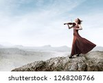 young attractive girl playing... | Shutterstock . vector #1268208766