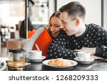 young couple talking in a cafe. ... | Shutterstock . vector #1268209333