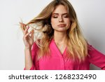 woman with closed eyes winds... | Shutterstock . vector #1268232490