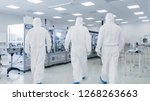 back shot of a three scientists ... | Shutterstock . vector #1268263663