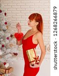 young sexy girl in a red dress...   Shutterstock . vector #1268266879