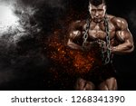 brutal strong muscular... | Shutterstock . vector #1268341390