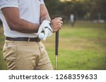the golfer holding the golf...   Shutterstock . vector #1268359633