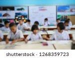 blur image of students... | Shutterstock . vector #1268359723