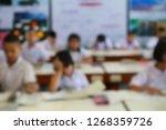 blur image of students... | Shutterstock . vector #1268359726