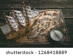 pirate ship  treasure map and a ... | Shutterstock . vector #1268418889