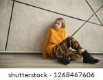 cute teen girl sitting near the ... | Shutterstock . vector #1268467606