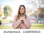 faithful woman closes eyes and... | Shutterstock . vector #1268540023