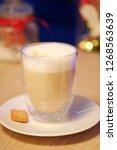 cup of latte macchiato on dark...   Shutterstock . vector #1268563639